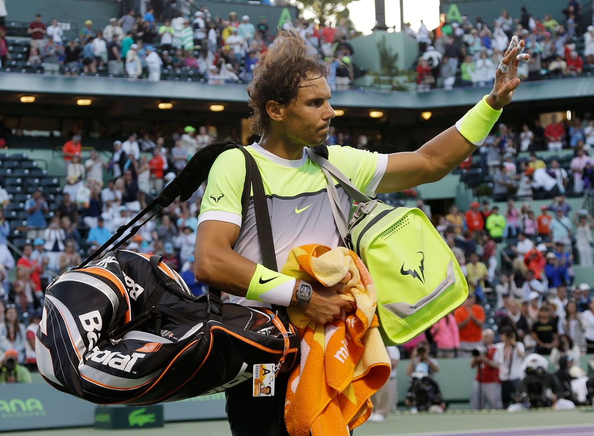 Rafael Nadal waves to the crowd after losing his third round match. (Photo: AP)