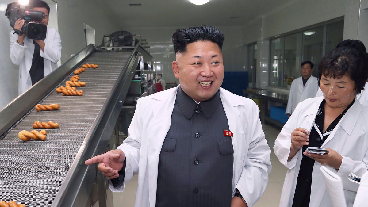 North Korean leader Kim Jong Un smiles as he gives field guidance during a visit to a food factory. (Photo: Reuters)