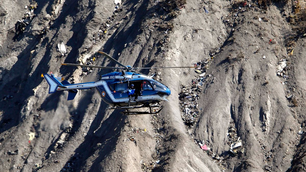 A French Gendarmerie rescue helicopter flies over the debris of the Airbus A320 at the site of the crash. (Photo: Reuters)