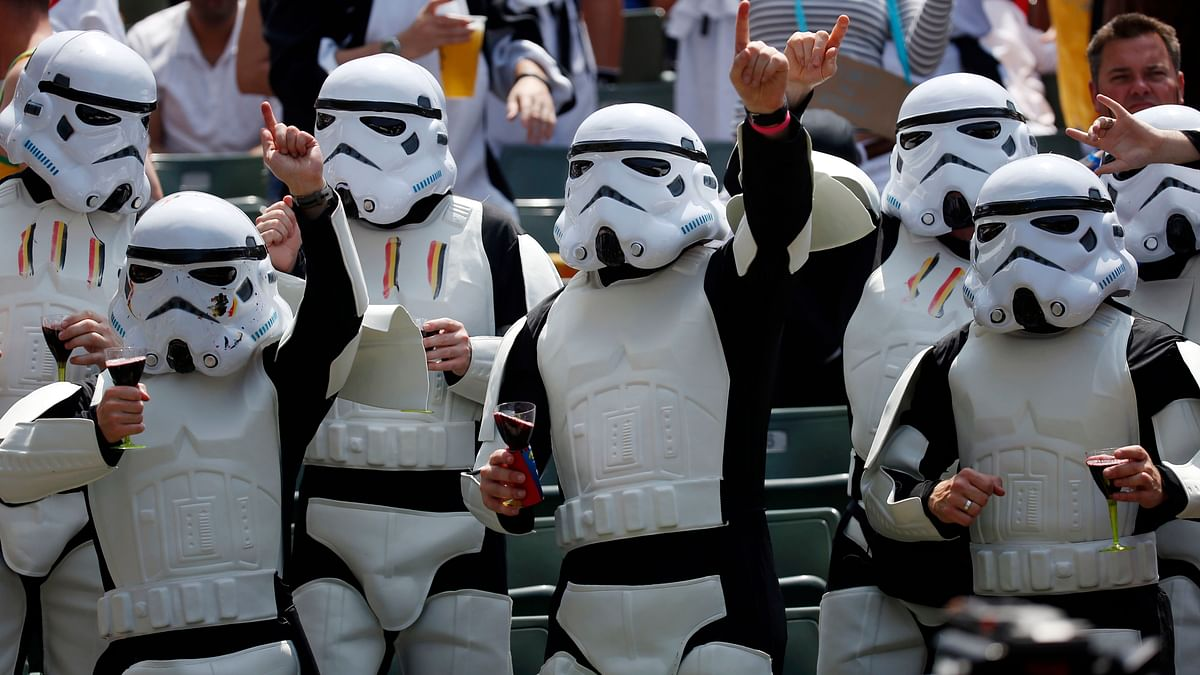 Rugby fans watching a game dressed as Star Wars 'Storm Troopers' in Hong Kong (Photo: AP)