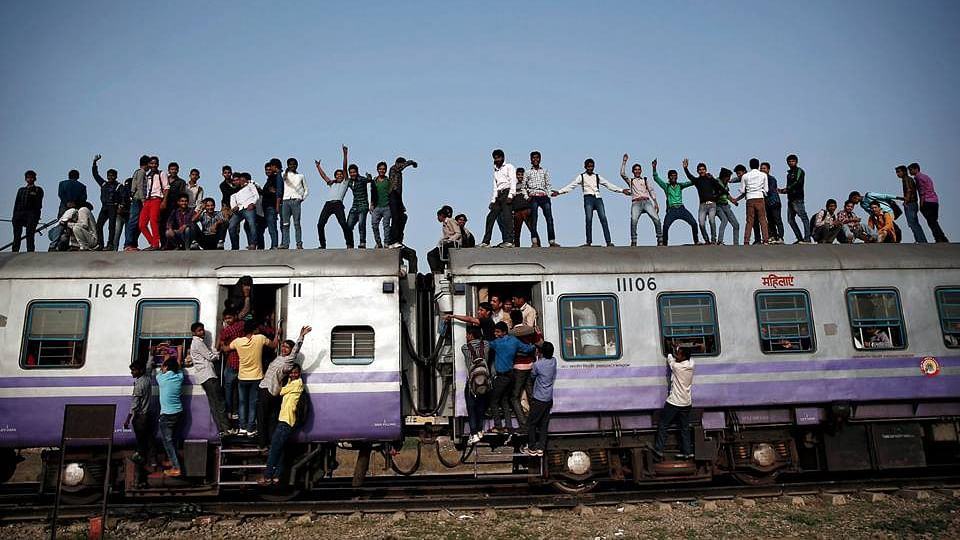 Passengers travel on an overcrowded train on the outskirts of New Delhi on February 26. Photo used for representational purpose. (Photo: Reuters/Ahmad Masood)