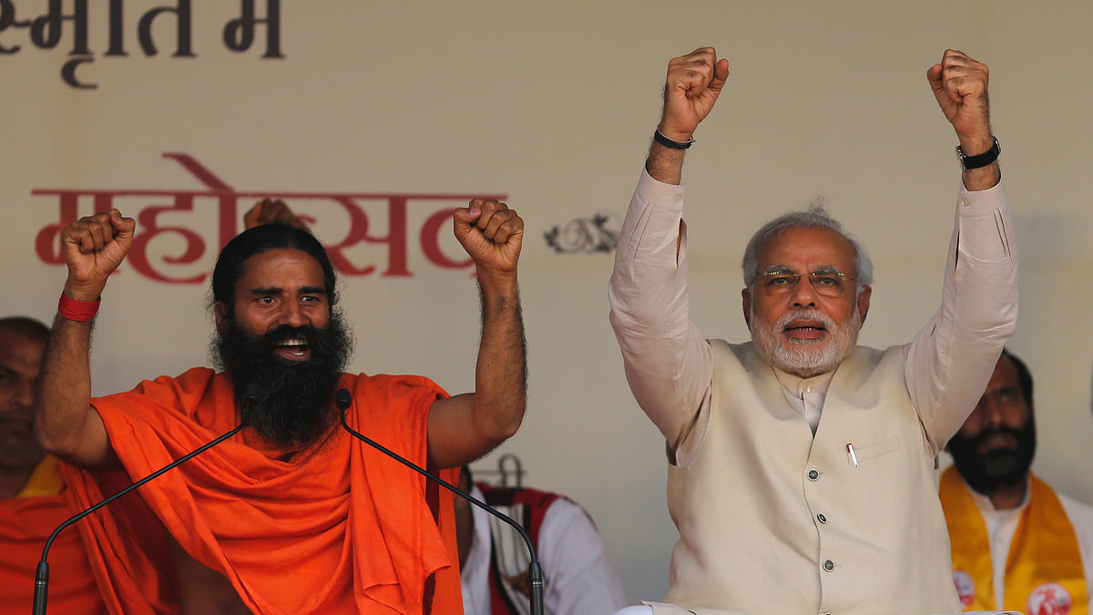 Baba Ramdev (L) with Prime Minister Narendra Modi (R) at a Yoga Festival in New Delhi. (Photo: Reuters)