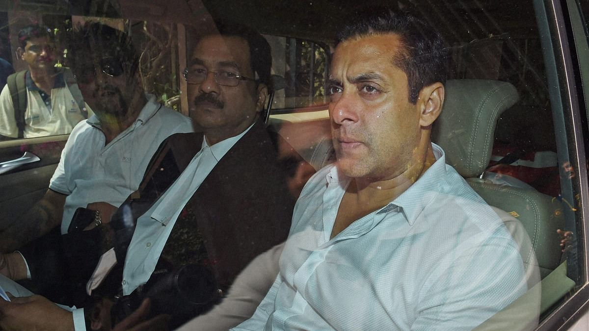 Bollywood actor Salman Khan, right, sits in a car outside a court in Mumbai outside the court. (Photo: AP)