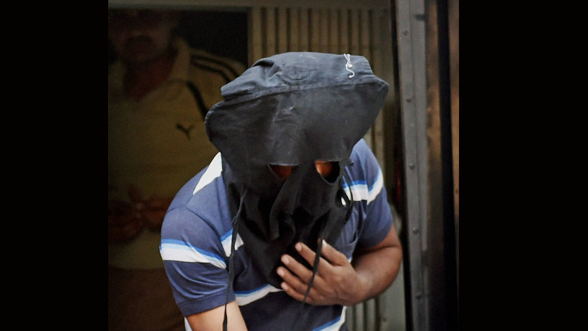 Abdul Wahab, accused in the Burdwan blast case being produced at a City Court by NIA in Kolkata. (Photo: PTI)