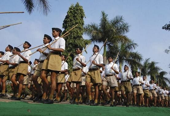 RSS activists hold bamboo sticks as they take part in a march in February, 2014 (Photo: Reuters)