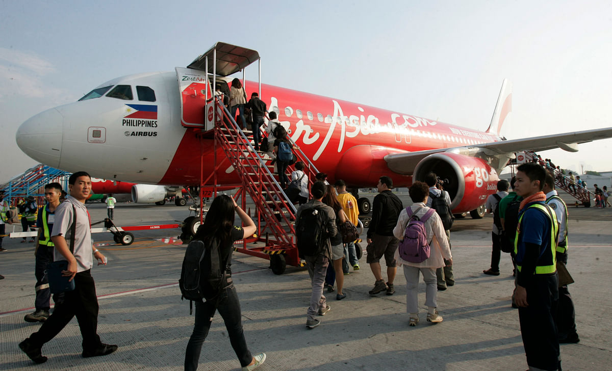 Passengers board an AirAsia Airbus A320 plane at the domestic airport in Manila. (Photo: Reuters)