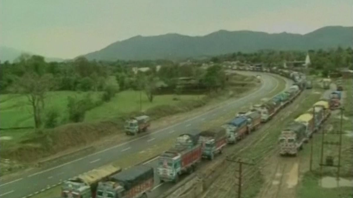Trucks stranded on the J&K highway on Monday due to landslide in Udhampur (Photo: ANI)