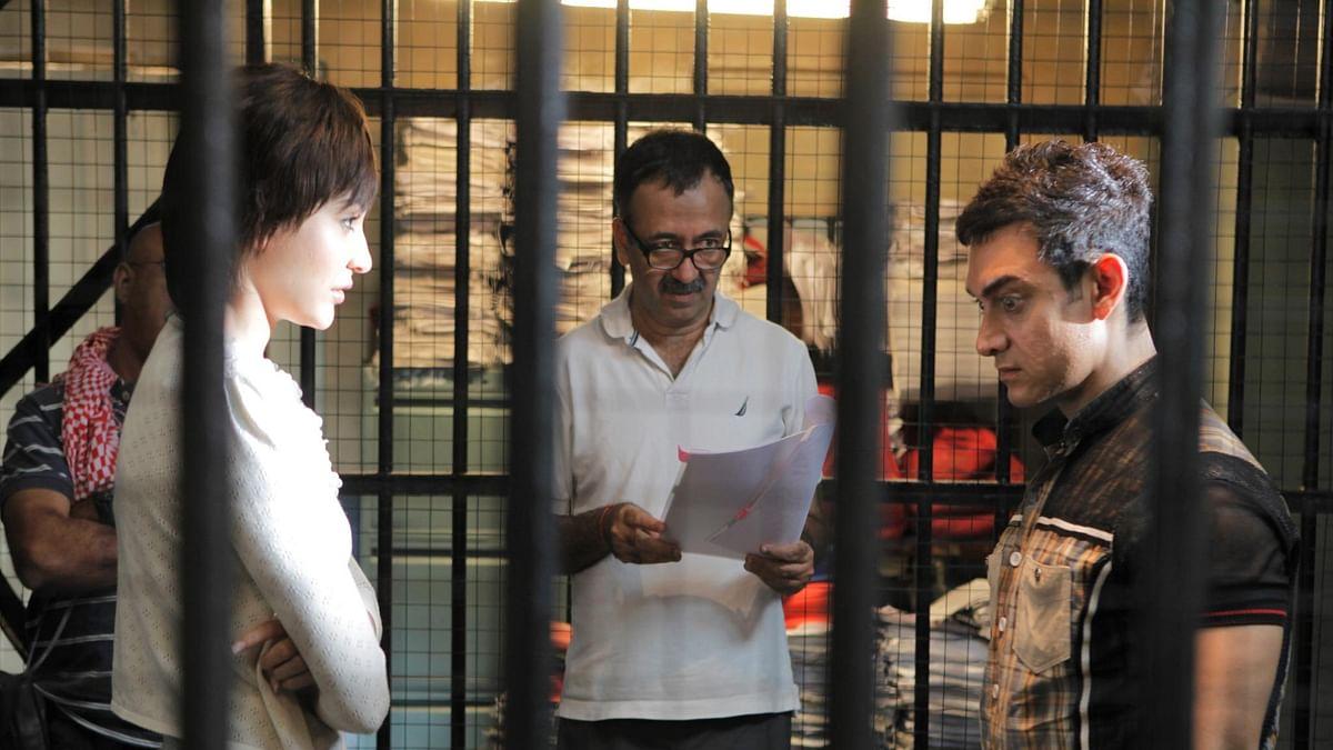 Rajkumar Hirani with Aamir Khan and Anushka Sharma on the sets of <i>PK.</i>