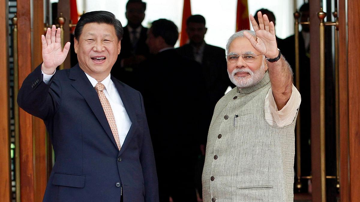 India's Prime Minister Narendra Modi (R) and China's President Xi Jinping. (Photo: Reuters)