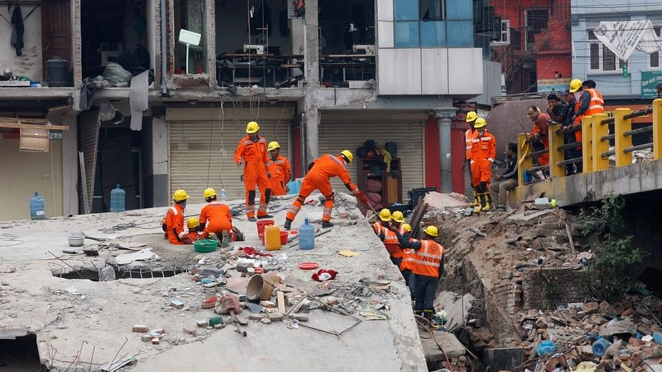 India's National Disaster Response Force (NDRF) personnel look for survivors in the debris. (Photo: AP)