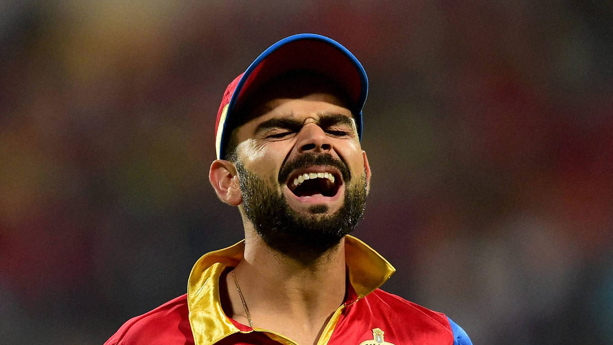 Virat Kohli reacts during his team's 8 wicket loss to Sunrisers Hyderabad in Bangalore on Monday. (Photo: BCCI/PTI)
