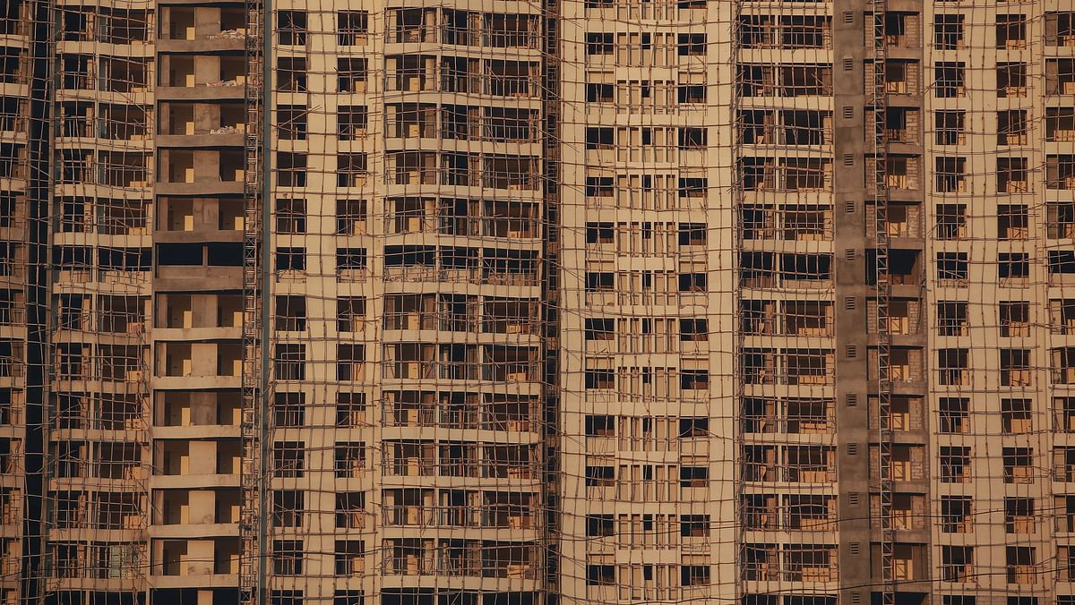 Windows of various apartments of an high-rise residential building under construction, are seen in a suburb of Mumbai.