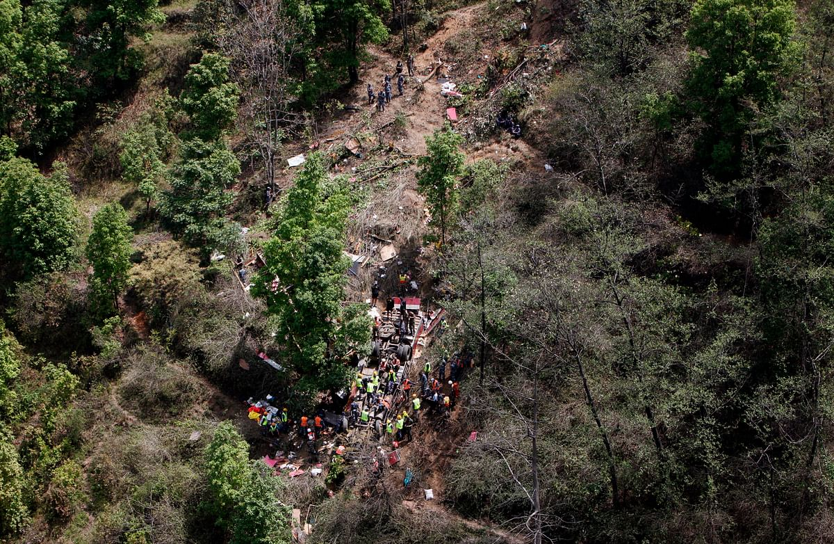 Nepalese rescue workers look for survivors in the wreckage of a bus after an accident, about 16 kilometers  west of Kathmandu in Nepal. (Photo:AP/Niranjan Shrestha)