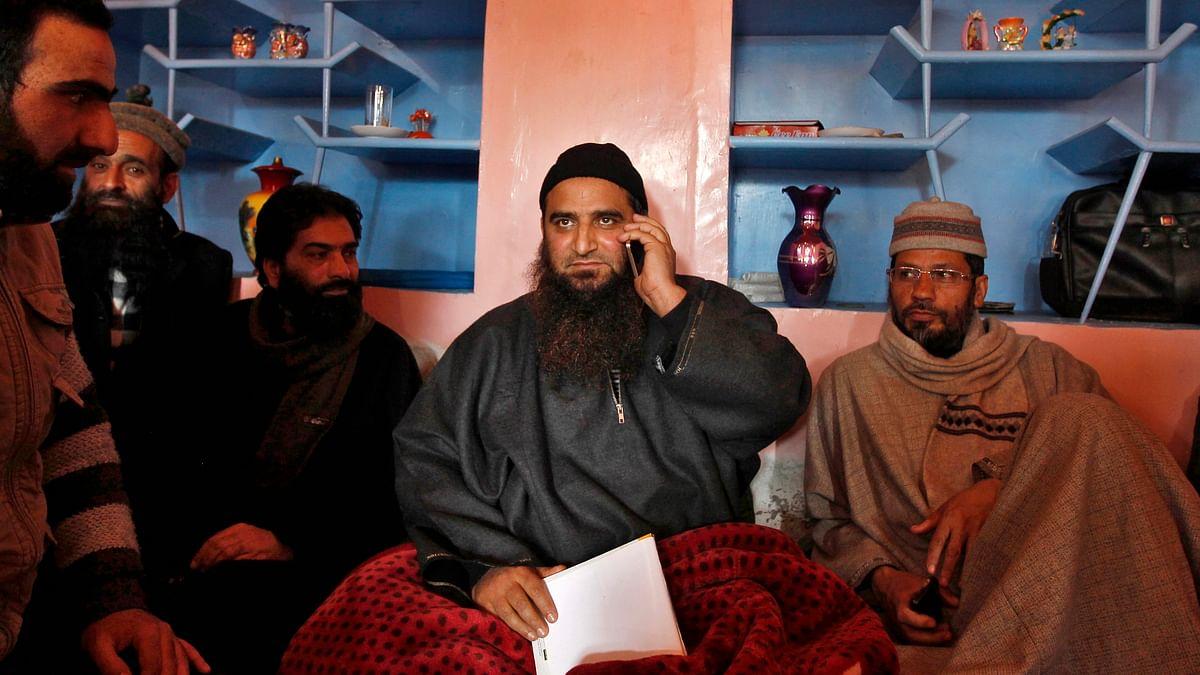 Kashmiri separatist leaderMasarat Alamspeaks on his mobile phone at his residence in Srinagar. (Photo: Reuters)