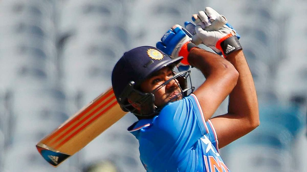 India's Rohit Sharma hits a six during their one day international tri-series cricket match against Australia at the Melbourne Cricket Ground in 2015.