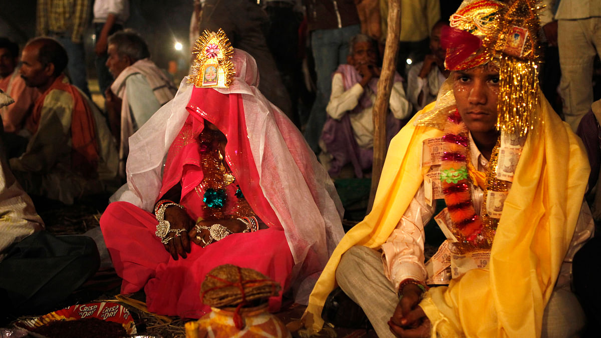 Kishan Gopal (R), 15, sits with his 12-year-old newly-wed wife Urmila in a mass marriage outside his village near Kota, Rajasthan. (Photo: Reuters)