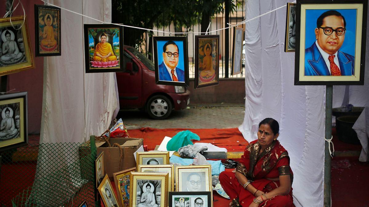 A vendor sells portraits of BR Ambedkar on a pavement in New Delhi. (Photo: Reuters)