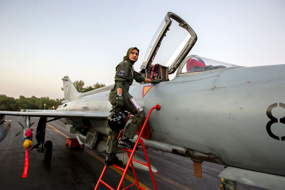 Ayesha Farooq, 26, Pakistan's only female war-ready fighter pilot, climbs up to a Chinese-made F-7PG fighter jet at Mushaf base in Sargodha, north Pakistan, June 6, 2013. (Photo: Reuters)<!--EndFragment-->