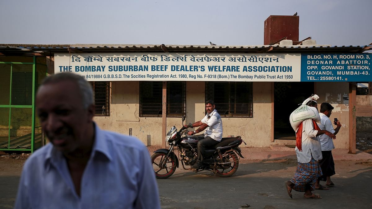 People walk past the beef dealers association office at an abattoir during a strike against a ban on the slaughter of bulls and bullocks in Mumbai March 23, 2015. (Photo: Reuters)