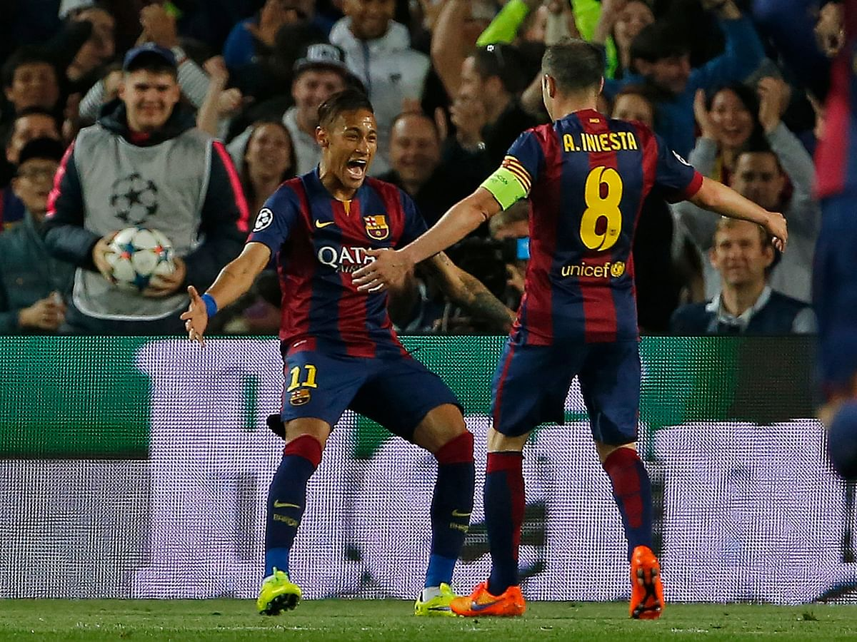 Barcelona's Neymar, left, celebrates with Andres Iniesta after scoring the opening goal during the Champions League quarterfinal second leg match against Paris Saint Germain at the Camp Nou. (Photo: AP)