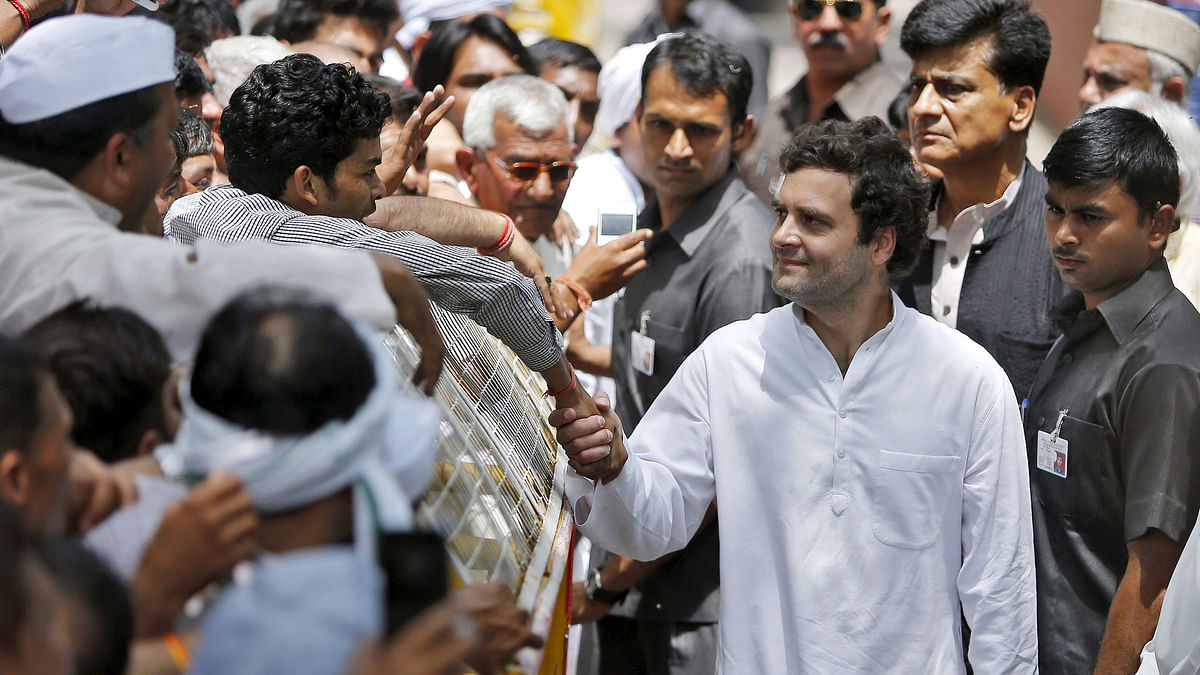 After his return, Congress Party Vice President Rahul Gandhi shakes hands with a farmer during his meeting with the farmers outside his residence in New Delhi. (Photo: Reuters)&nbsp;<!--EndFragment-->