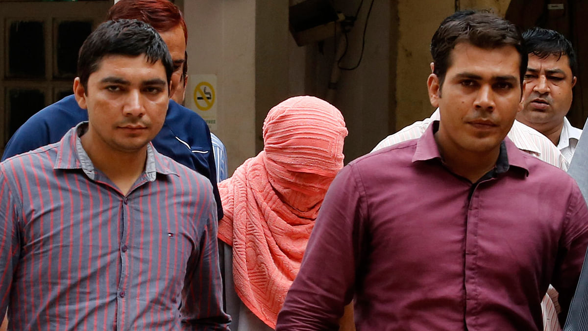 Policemen escort the juvenile convicted&nbsp;in the December gang rape case of&nbsp;2012. The case sparked a debate on juvenile criminals being tried under adult laws. (Photo: Reuters) <!--EndFragment-->