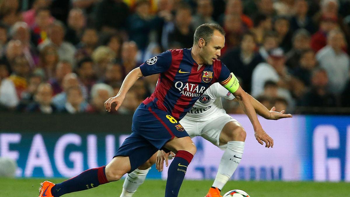 Barcelona's Andres Iniesta runs with the ball during the Champions League quarterfinal second leg match against Paris Saint Germain at the Camp Nou. (Photo: AP)