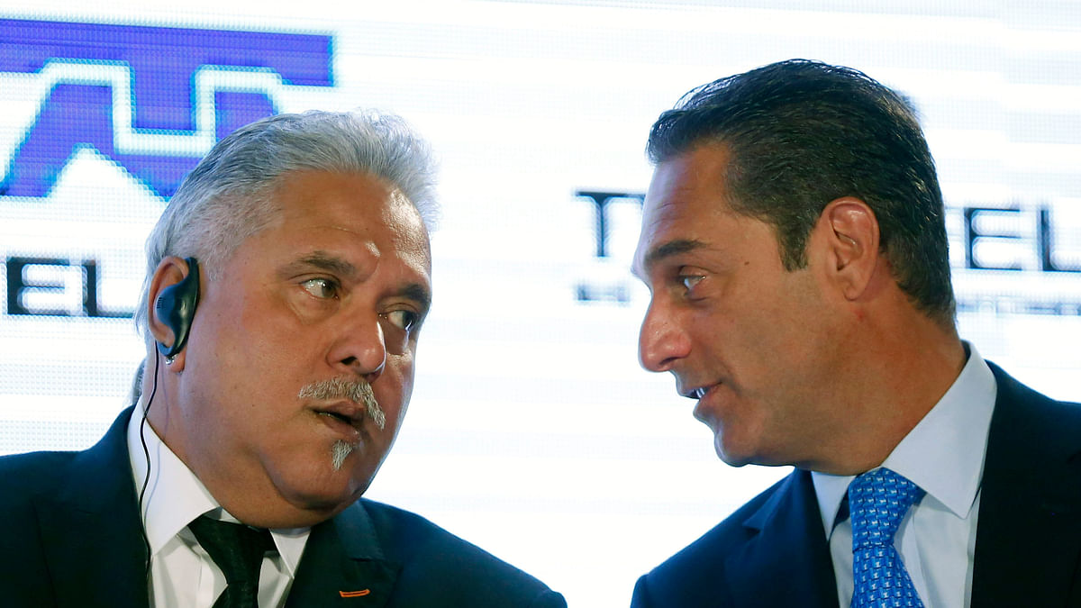 Force India team principal Vijay Mallya (L) speaks with Chairman of the Board of Directors of Grupo Carso Carlos Slim Domit during the presentation of the new Force India racing car at Soumaya museum in Mexico City January 21, 2015.