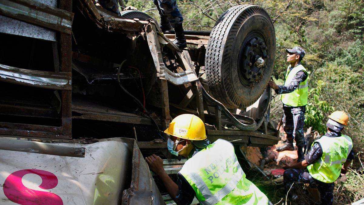 Rescue workers search for victims at the site of a bus accident. (Photo: AP/Niranjan Shrestha)