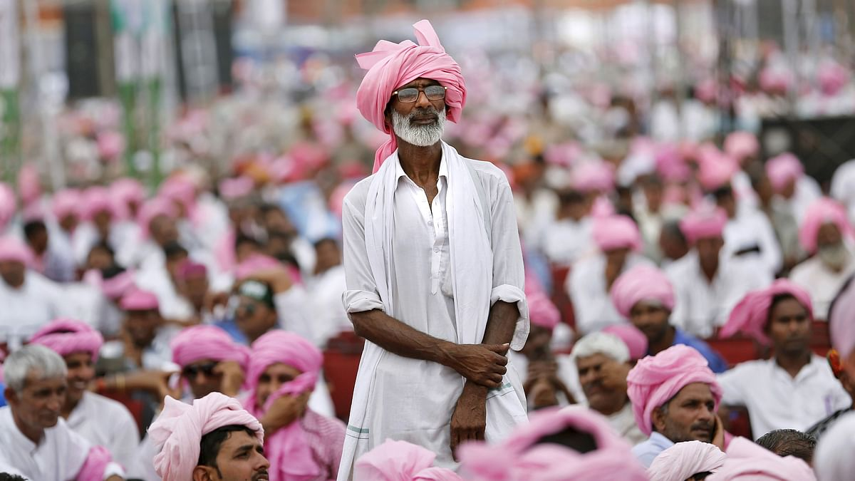 A farmer stands as he listens to a speech by India's Congress vice-president Rahul Gandhi at a farmers rally at Ramlila ground in Delhi on April 19, 2015. (Photo: Reuters)