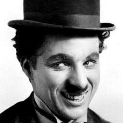 That mischievous Chaplin smile.