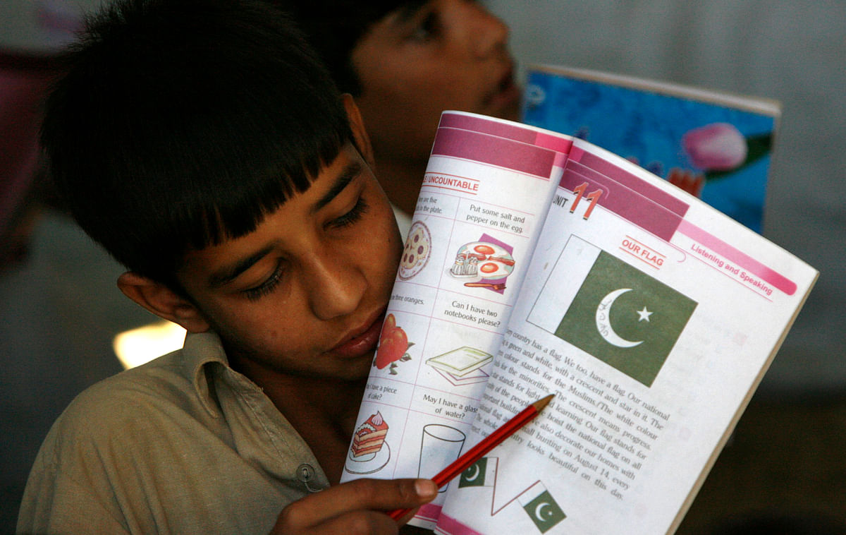 A Pakistani School boy reads a passage from his book. (Photo: Reuters)
