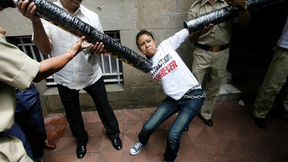 Security personnel try to restrain a Greenpeace activist during a blockade of the Tata Group's HQ in Mumbai (Photo: Reuters)