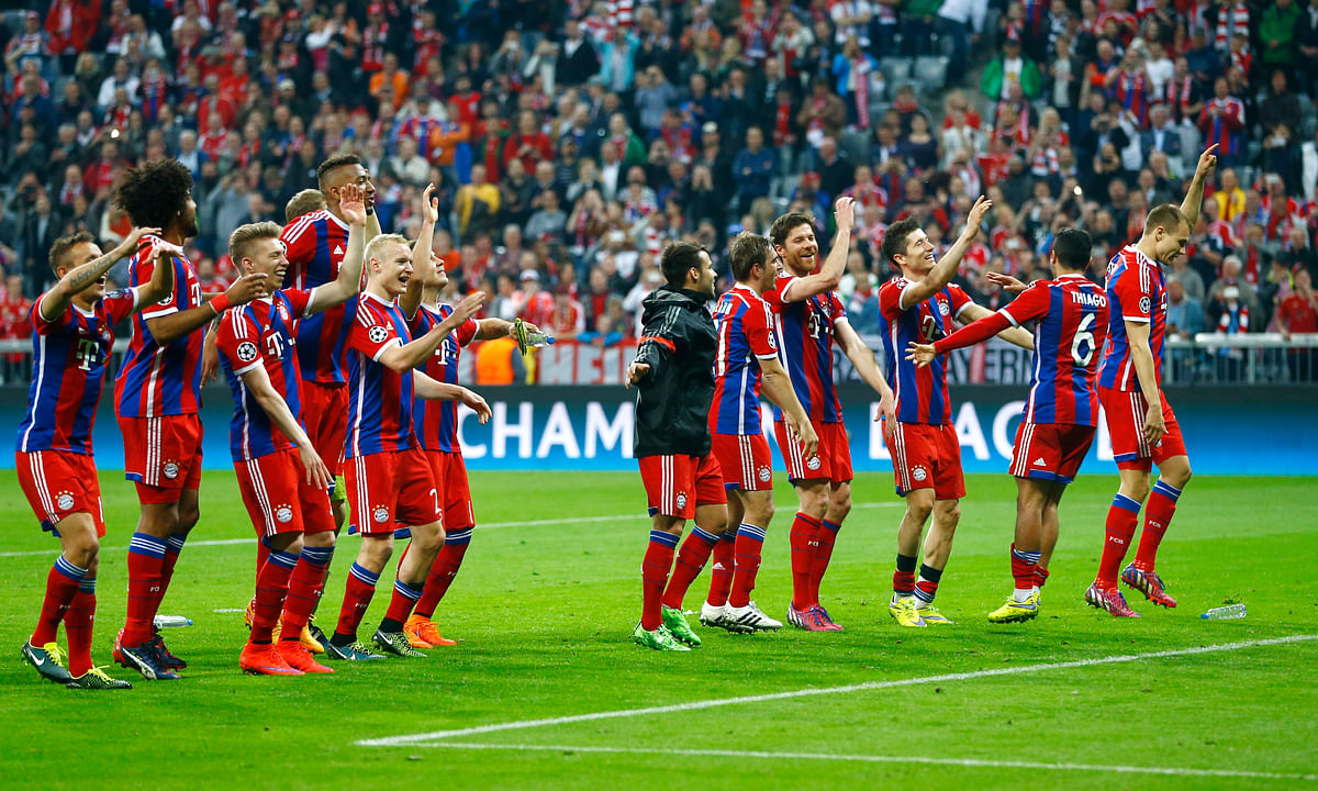 Bayern players acknowledge the fans after winning 6-1 during the soccer Champions League quarterfinal second leg match against FC Porto at the Allianz Arena in Munich,. (Photo: AP)