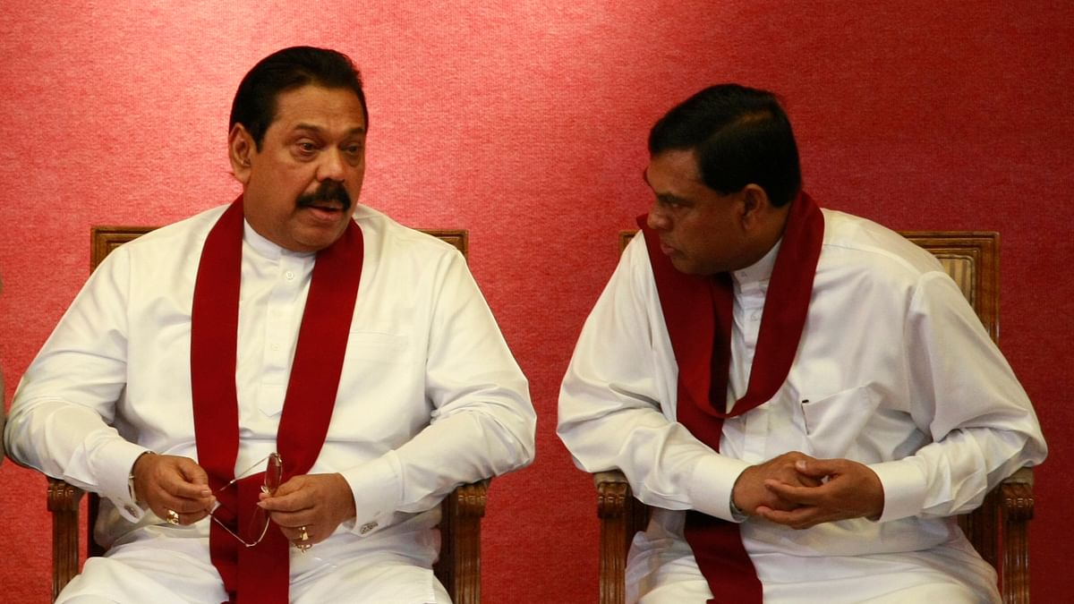 Sri Lanka's Ex-President Mahinda Rajapaksa (L) and Economic Development Minister Basil Rajapaksa in 2011. (Photo: Reuters)<!--EndFragment-->