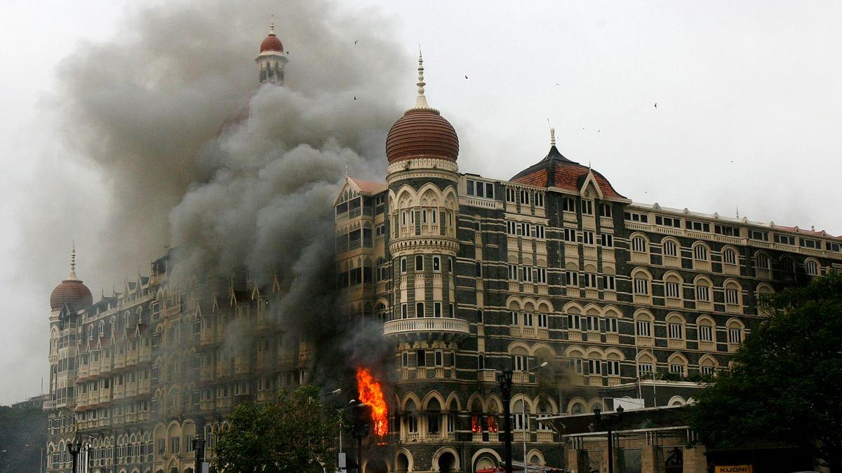 The Taj Mahal hotel is seen engulfed in smoke during a gun battle in Mumbai, November 2008. (Photo: Reuters)