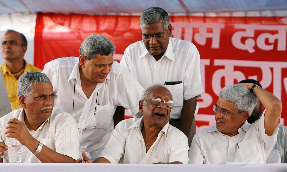 (Left to Right) Senior communist leaders Debabrata Biswas, Sitaram Yechury, AB Bardhan, D Raja (standing) and Prakash Karat.(Photo: Reuters/Adnan Abidi)