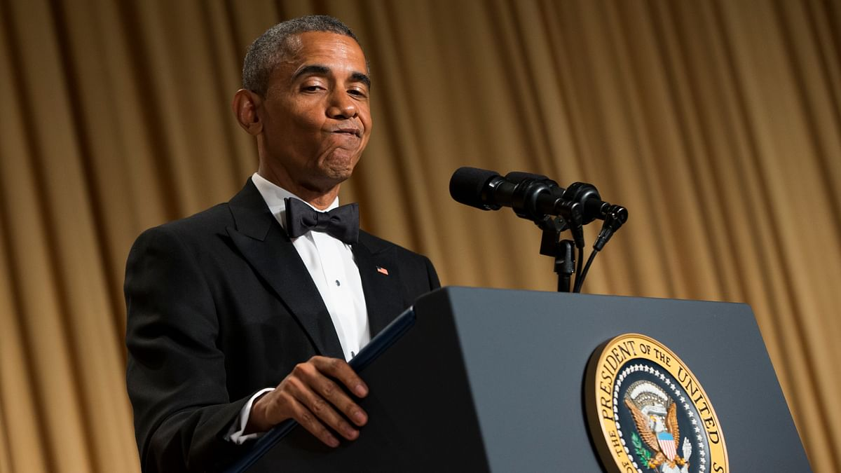 President Barack Obama gestures as he delivers remarks during the White House Correspondents' Association dinner at the Washington Hilton on Saturday (Photo:AP)