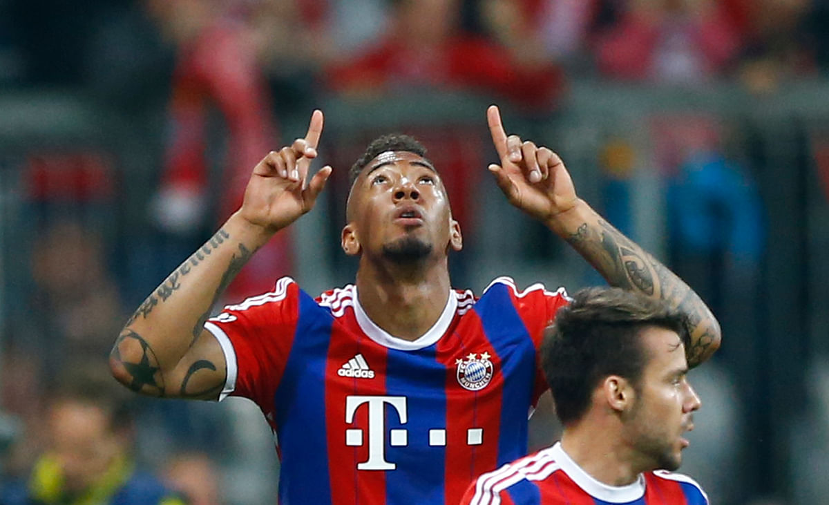 Bayern's Jerome Boateng celebrates after scoring his side's 2nd goal against FC Porto at the Allianz Arena in Munich. (Photo: AP)