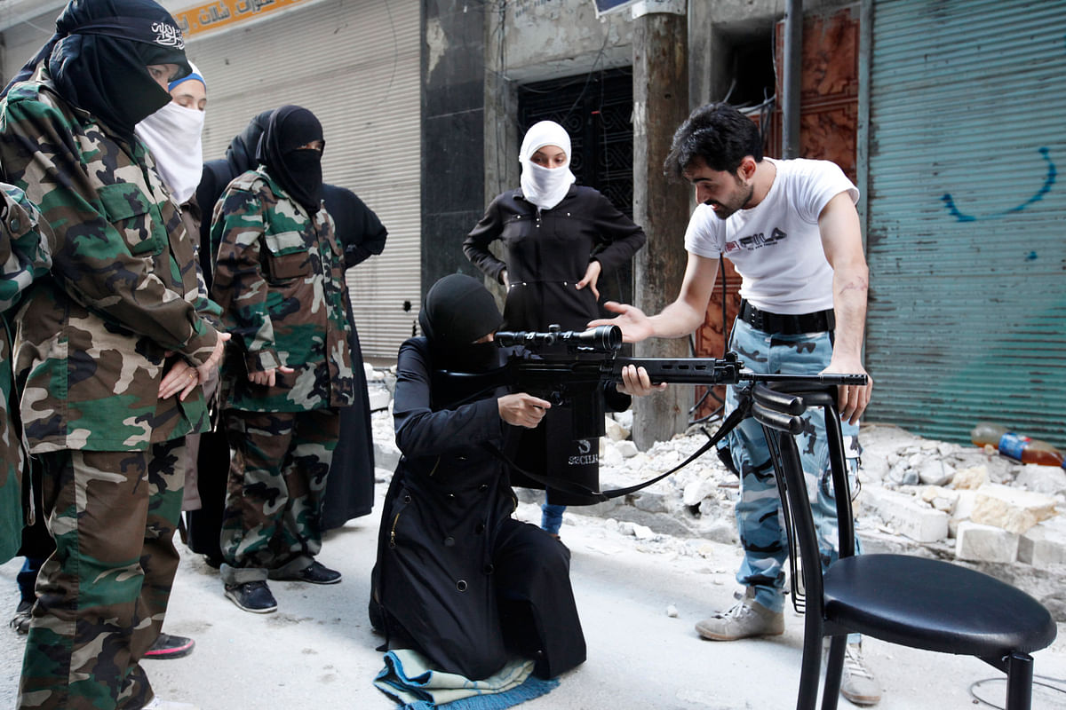 <!--StartFragment-->A female member of the 'Mother Aisha' battalion receives instructions as she holds a rifle during military training in Aleppo, Syria. (Photo: Reuters)<!--EndFragment-->