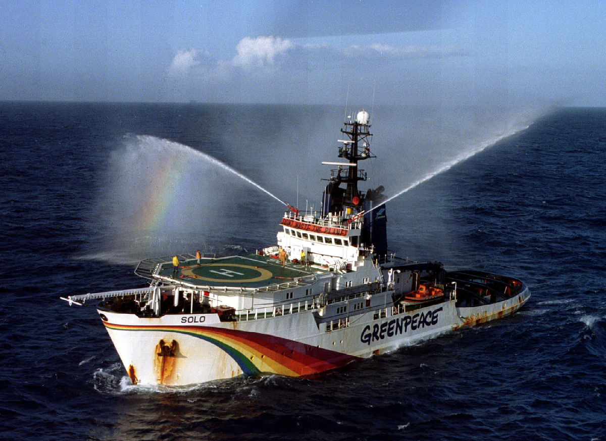 "The Greenpeace vessel ""Solo"" fires it's water cannons after hearing that Shell had abandoned plans to dump the oil storage rig Brent Spar in the North Atlantic. (Photo: Reuters)"