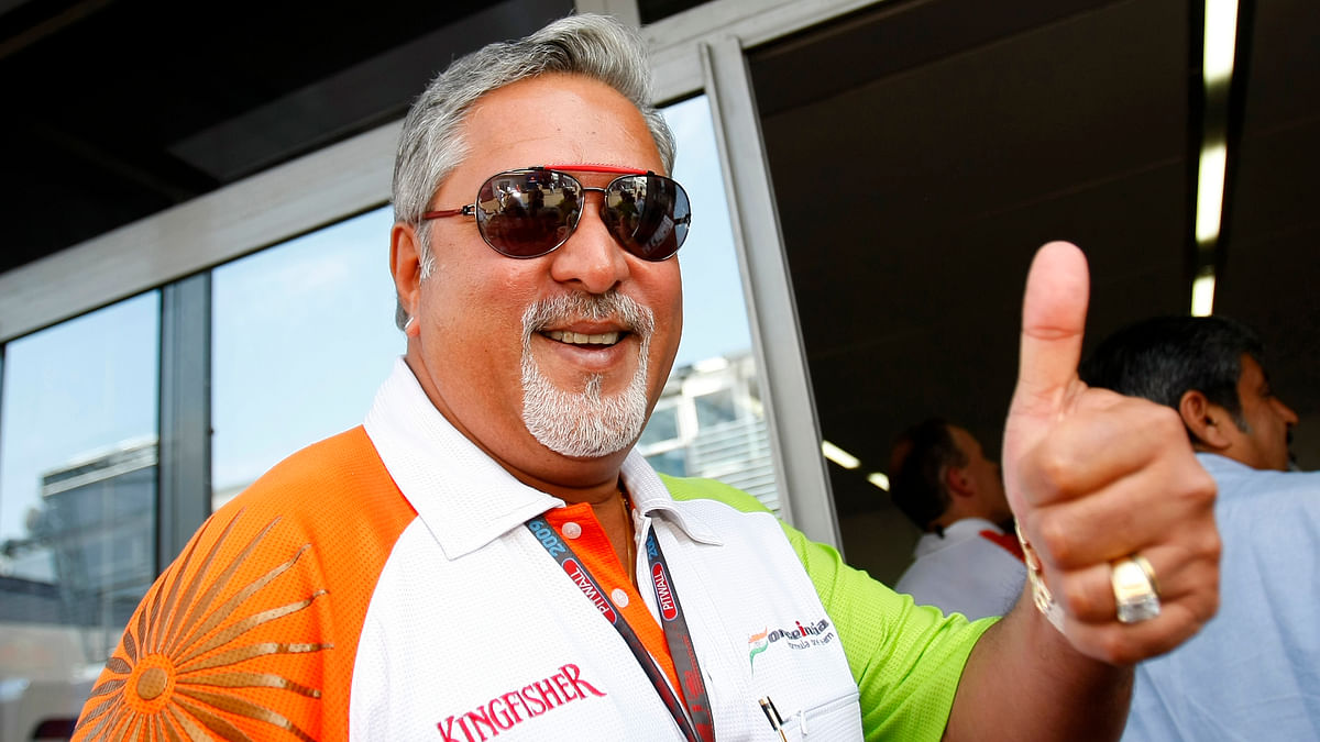 Force India team owner Vijay Mallya gives the thumb up at the end of the third practice session of the Italian F1 Grand Prix in Monza September 12, 2009. (Photo: Reuters)
