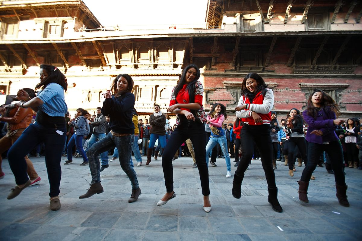 Students perform a Gangnam Style dance along the streets of Basantapur Durbar Square during an event. (Photo: Reuters)