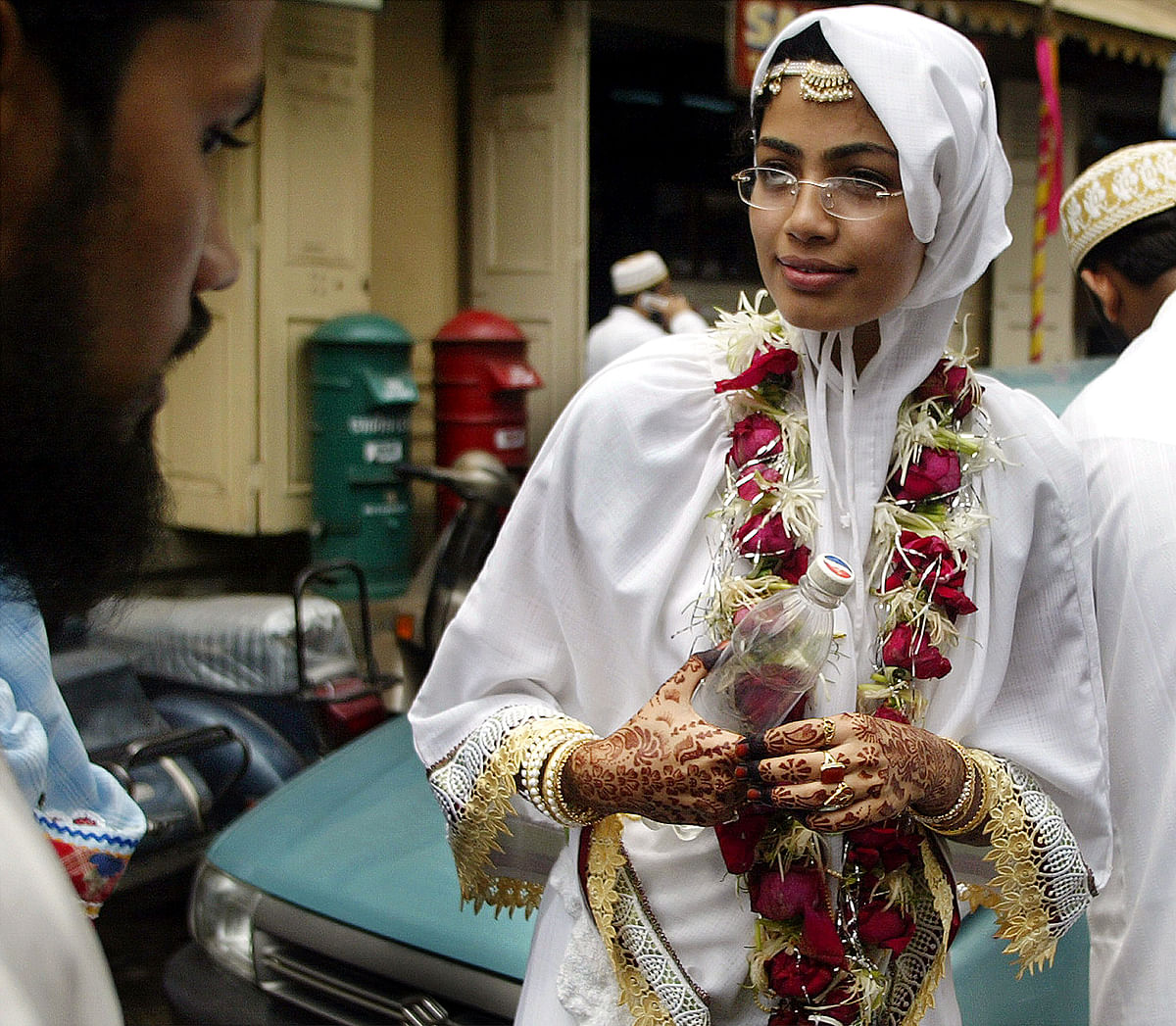 A bride in a traditional attire after participating in a mass wedding ceremony.