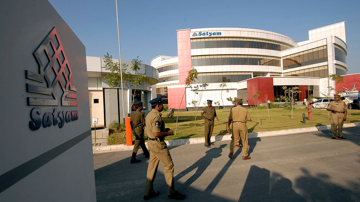 Policemen walk inside the Satyam Computer Services head office in the southern Indian city of Hyderabad 12 January 2009