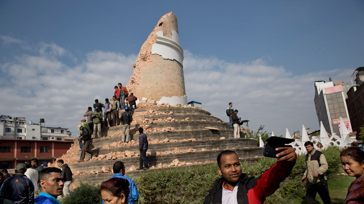 A man takes a selfie at the historic Dharahara Tower, a city landmark, that was damaged in Saturday's earthquake in Kathmandu, Nepal, Monday, April 27, 2015. (Photo: AP)