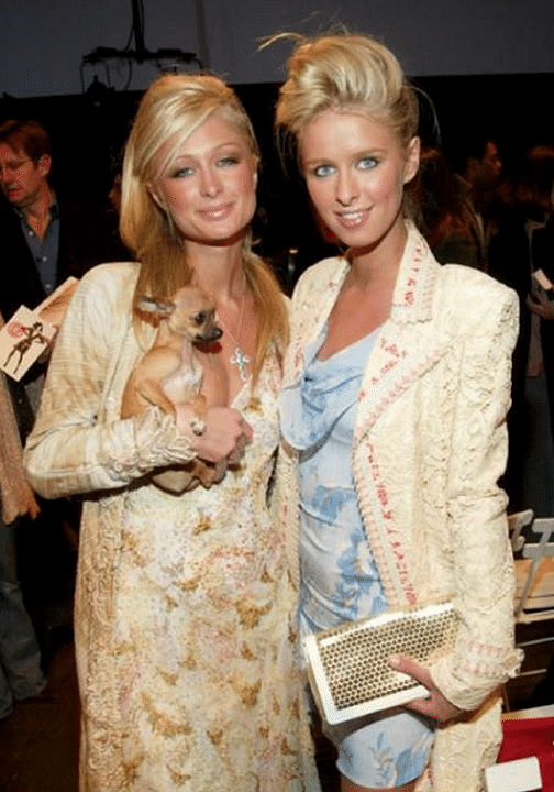 """Paris Hilton and Nicky Hilton at a fashion event&nbsp;with Tinkerbell (Photo: <a href=""""https://www.facebook.com/parishilton"""">Facebook/Paris Hilton</a>)"""
