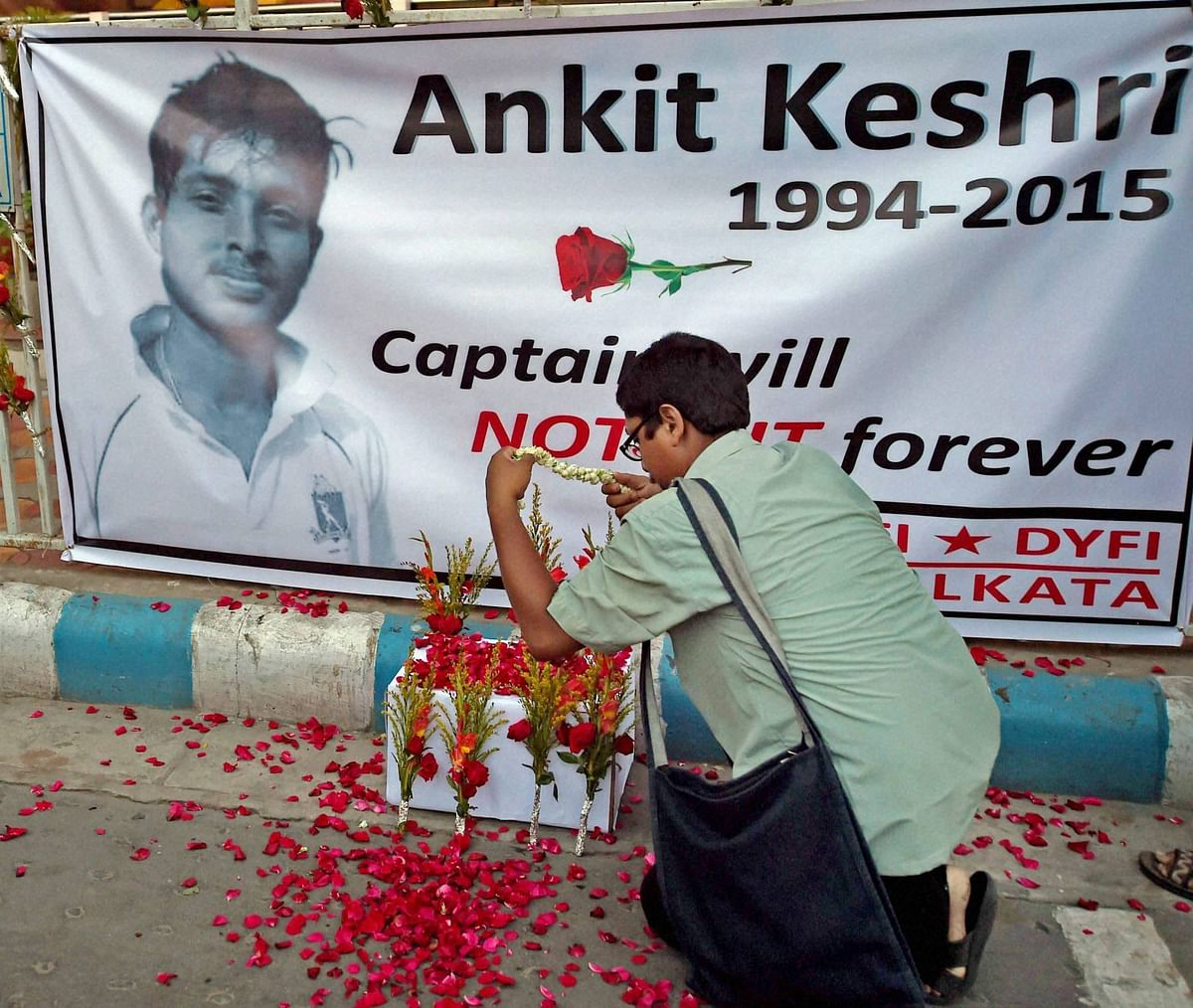 A manpaying floral tribute to Bengal U-19 Cricketer Ankit Keshri, who died after sustaining an injury in a match, infront of CAB(Cricket Association of Bengal) in Kolkata on Tuesday. (Photo: PTI)