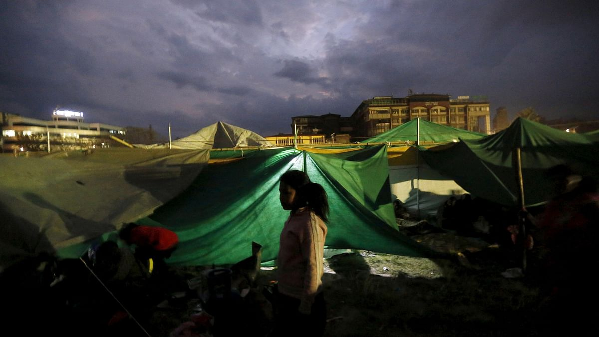 A girl stands outside her makeshift shelter at an open ground after an earthquake in Kathmandu, Nepal on April 26, 2015. (Photo: Reuters)