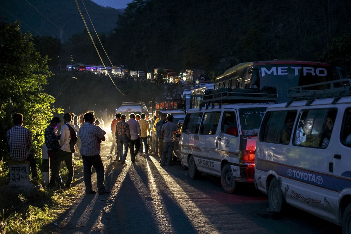 <!--StartFragment-->People gather on a road as traffic is affected by a landslide caused by an earthquake, in Kurintar, Nepal. (Photo: Reuters)<!--EndFragment-->